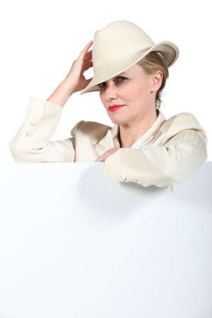 horse racing: Woman holding hat