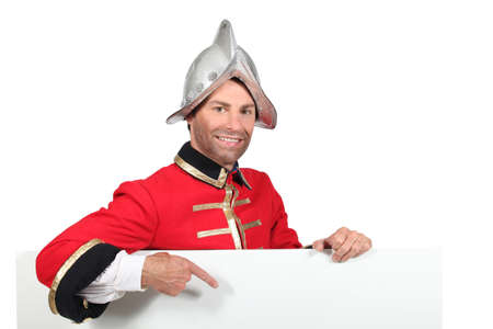 historical periods: Man dressed as a soldier Stock Photo