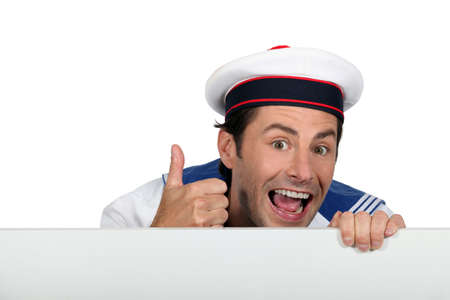 Silly sailor with a board Stock Photo - 17506376