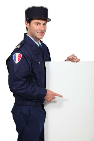 French policeman with poster photo