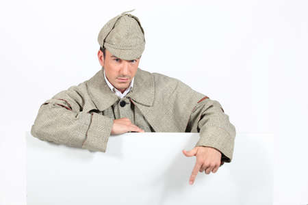 a detective showing a copyspace Stock Photo - 17506246