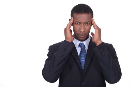 splitting headache: Businessman holding head Stock Photo