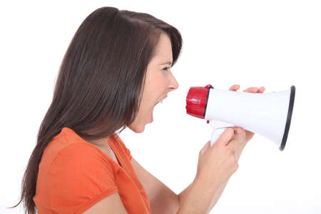 Woman screaming into a megaphone photo