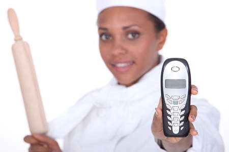 voicemail: Chef holding up a telephone Stock Photo