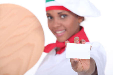 Woman pizza maker showing card Stock Photo - 17506356