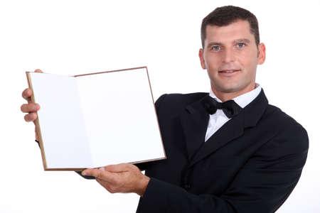 waiter showing menu Stock Photo - 17506354