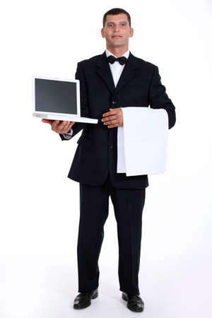 waiter holding a laptop Stock Photo - 17506360