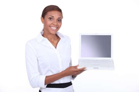 Woman demonstrating a laptop photo