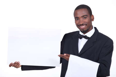 Studio shot of a waiter with a board left blank for your image photo