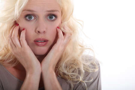 fear face: portrait of young blonde looking scared