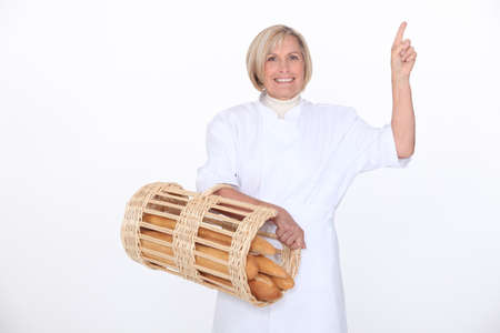 a mature female baker showing something photo