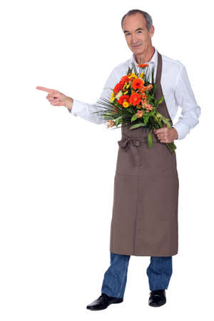 median age: Florist indicating the place Stock Photo