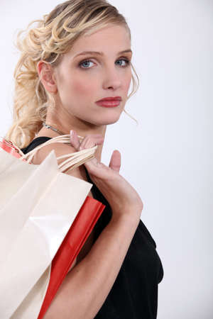 hauteur: Glamorous woman with store bags