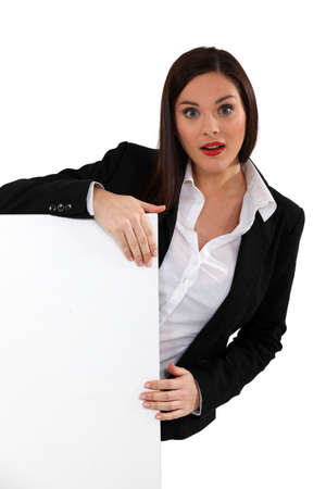 Businesswoman with a board left blank for your message Stock Photo - 17577864