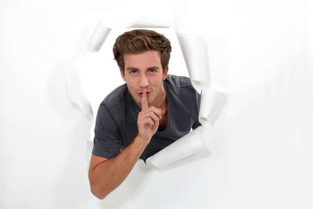 Man making shush gesture