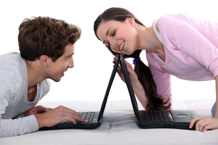 interactivity: Couple with laptops