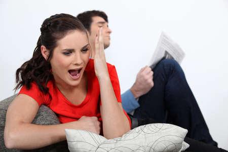 reversal: Woman watching a football game