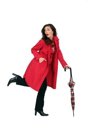 Woman in a red mac with an umbrella photo