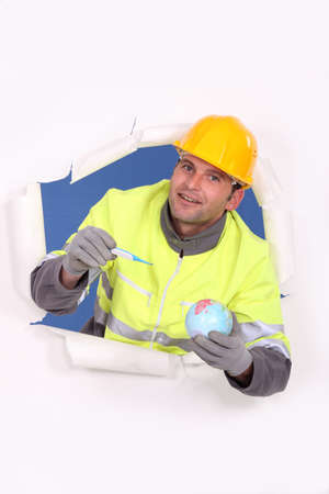 Builder with a globe and thermometer Stock Photo - 17578139