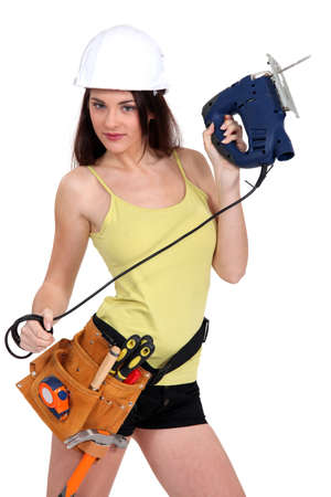 female construction worker: Handywoman holding a jigsaw. Stock Photo