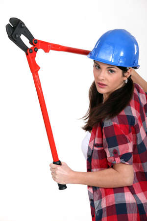 Woman with a pair of bolt cutters photo