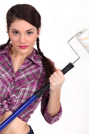 knotted: Woman holding up a paint roller