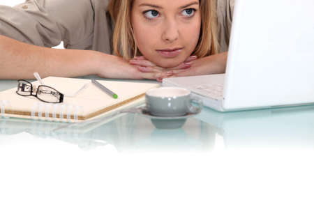 workaholic: Woman peering at her laptop