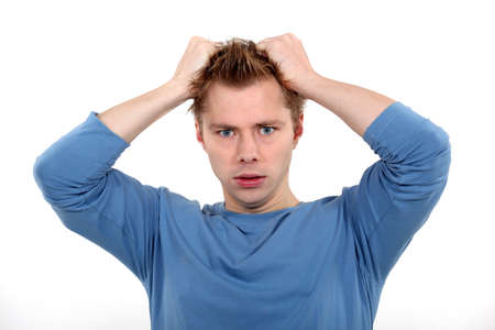 Man pulling own hair Stock Photo - 17583972