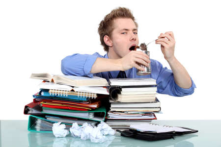 overwhelmed worker eating from a tin Stock Photo - 17579706