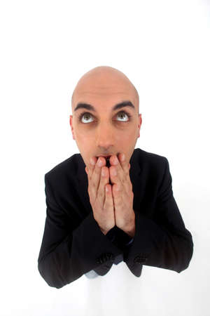 Bald man with expression of surprise on white background photo