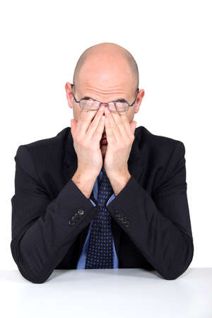 boring frame: Tired man rubbing his eyes Stock Photo