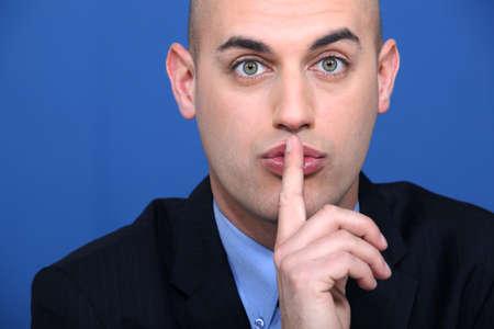 Bald businessman making shush gesture Stock Photo - 17583361