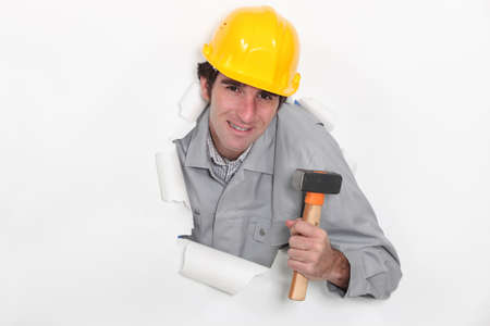Construction worker with a mallet photo