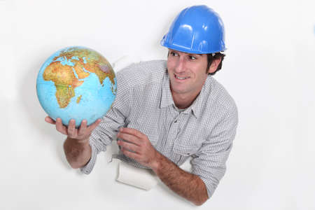 Construction worker holding a globe photo