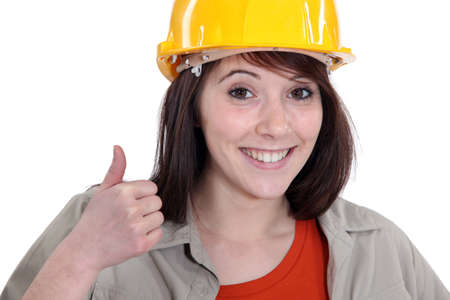 Female builder giving thumbs-up photo