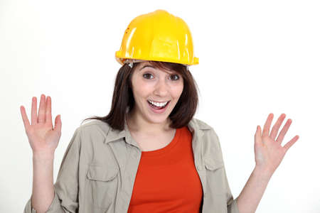 Happy brunette builder waving hands Stock Photo - 17579575