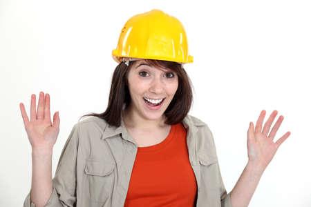 Happy brunette builder waving hands Stock Photo - 17579575