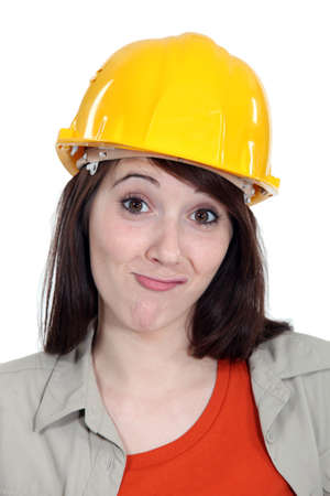 ambivalence: Bemused female builder Stock Photo