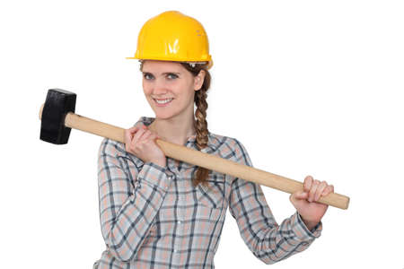 Handywoman holding hammer photo