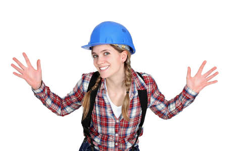 delighted: Tradeswoman holding up her hands