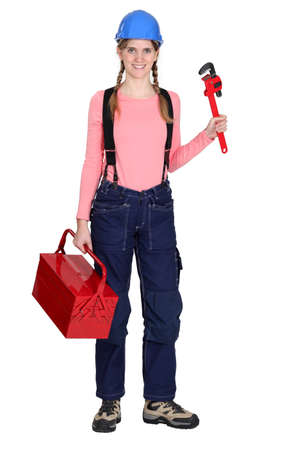tradeswoman: Tradeswoman with a pipe wrench