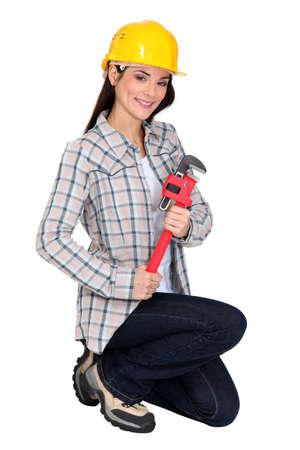 engineer's: Female builder brandishing adjustable wrench Stock Photo