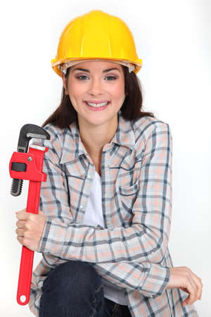 Woman holding adjustable wrench photo