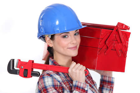 Woman holding wrench and tool box photo