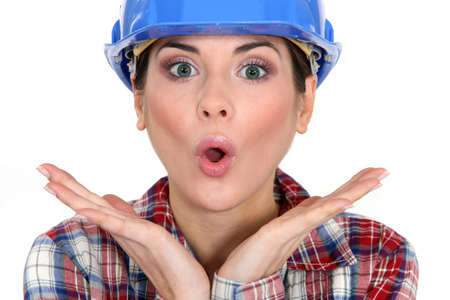 disconcert: Shocked female worker Stock Photo