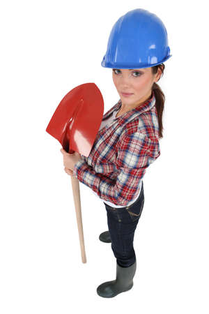 supercilious: Female construction worker with a shovel Stock Photo