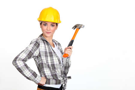 hair tied: Woman holding a hammer. Stock Photo