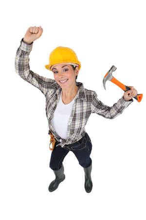 Mason jubilant women with hammer in hand