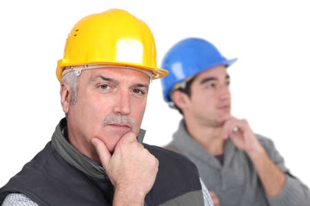 Thoughtful tradesmen Stock Photo - 17578570