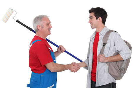 experienced: Experienced tradesman welcoming his new recruit